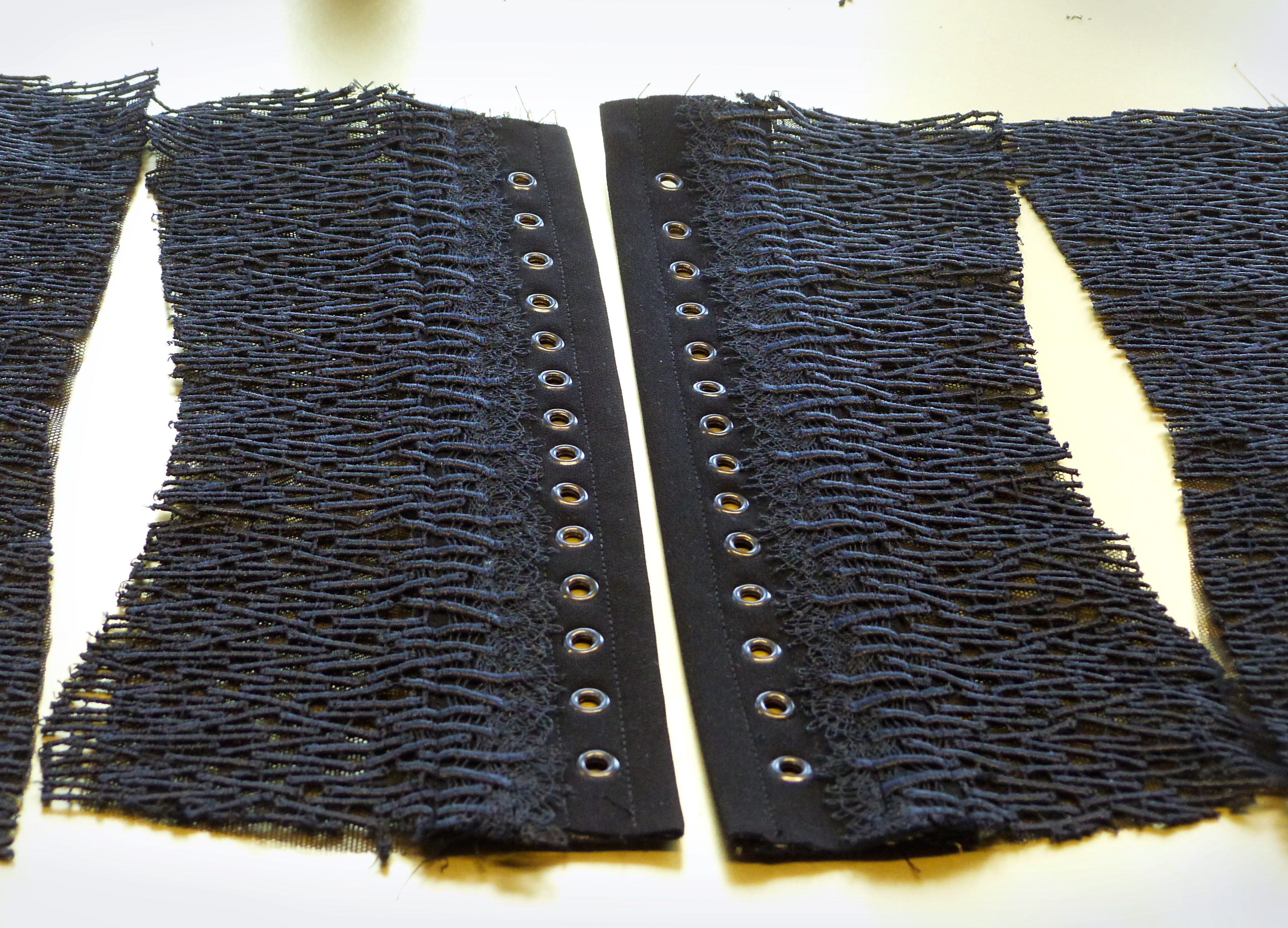 """Arbeit am Spitzenbustier im Atelier """"entre nous"""" - the lace corset made from lace of St.Gallen on the mesh foundation"""